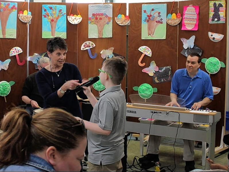 Rotary Club of Naperville members work with the Flashpoint Foundation from North Central College to expose youth assisted by the disability services organization Little Friends with jazz music for therapeutic benefits.
