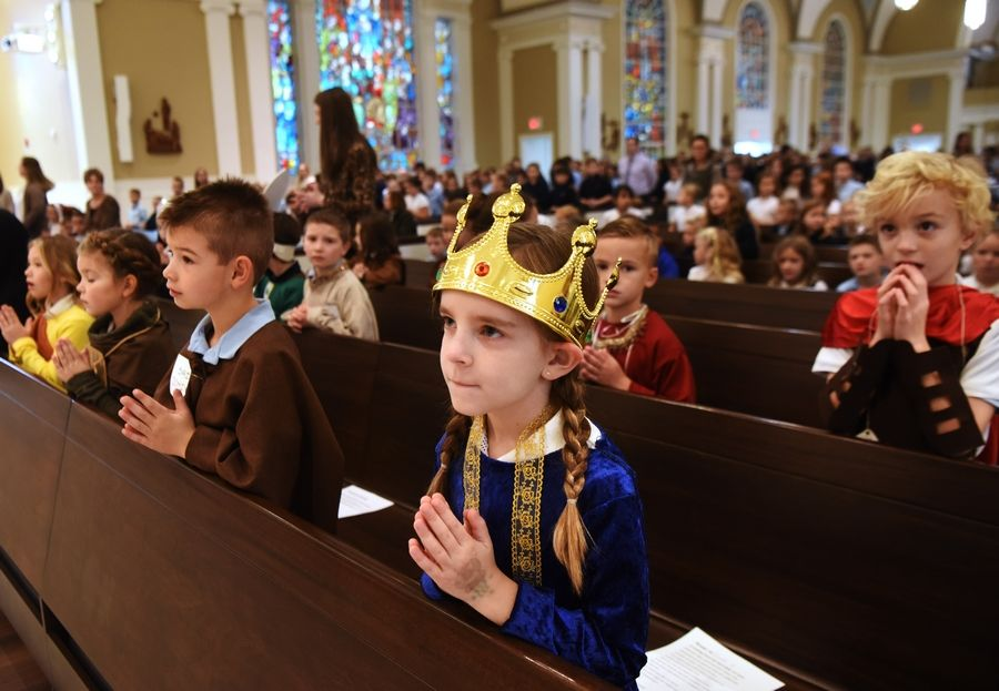 Sadie Glenn is among the first-graders dressed as saints Friday during the All Saints Day Mass at St. James Catholic Church in Arlington Heights.