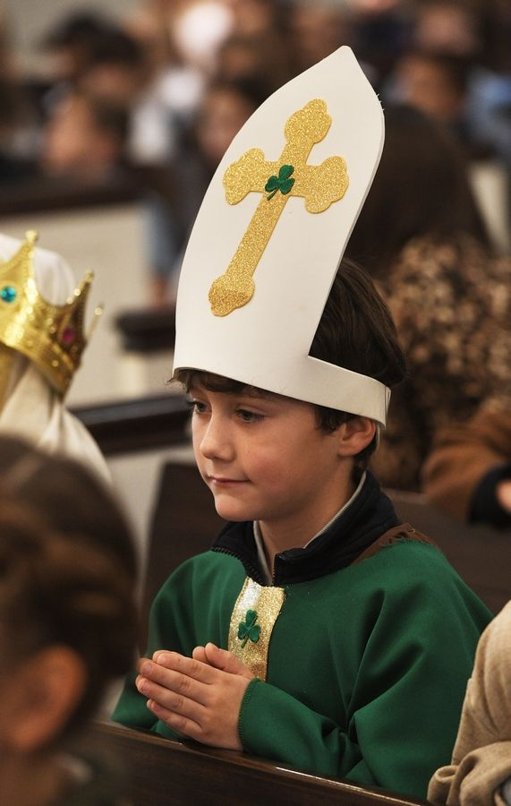 First-grader Colin McLeod portrays St. Patrick on Friday during the All Saints Day Mass at St. James Catholic Church in Arlington Heights.