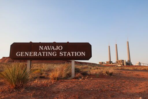 This Aug. 19, 2019, image shows the coal-fired Navajo Generating Station near Page, Ariz. The power plant will close before the year ends, upending the lives of hundreds of mostly Native American workers who mined coal, loaded it and played a part in producing electricity that powered the American Southwest.