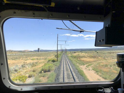 This Aug. 20, 2019, image shows the train tracks that serve as an artery between a coal mine near Kayenta, Ariz. and the coal-fired Navajo Generating Station near Page. The power plant will close before the year ends.