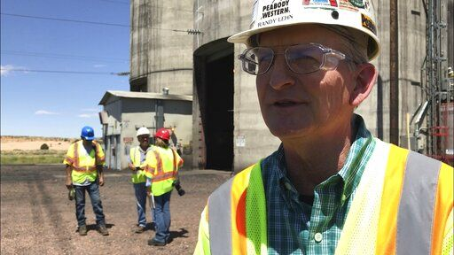 In this Aug. 20, 2019, image, Kayenta Mine acting general manager Randy Lehn talks about unsuccessful efforts to keep the coal mine near Kayenta, Ariz. in operation. The mine in August delivered its last load of coal to the Navajo Generating Station near Page, Ariz. The power plant will close before the year ends.