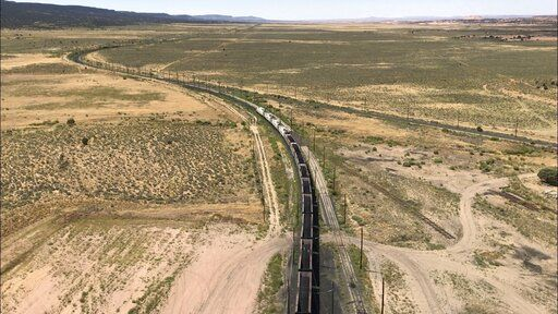 This Aug. 20, 2019, image shows a mile-long train leaving a coal silo near Kayenta, Ariz. en route to the Navajo Generating Station near Page. The electric train made its last delivery in late August as the coal-fired power plant prepared to close before the year ends.