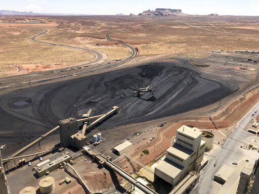 This Aug. 20, 2019, image shows the coal stockpile at the Navajo Generating Station near Page, Ariz. Before the end of the year, the power plant near the Arizona-Utah border will close and others in the region are on track to shut down or reduce their output in the next few years.