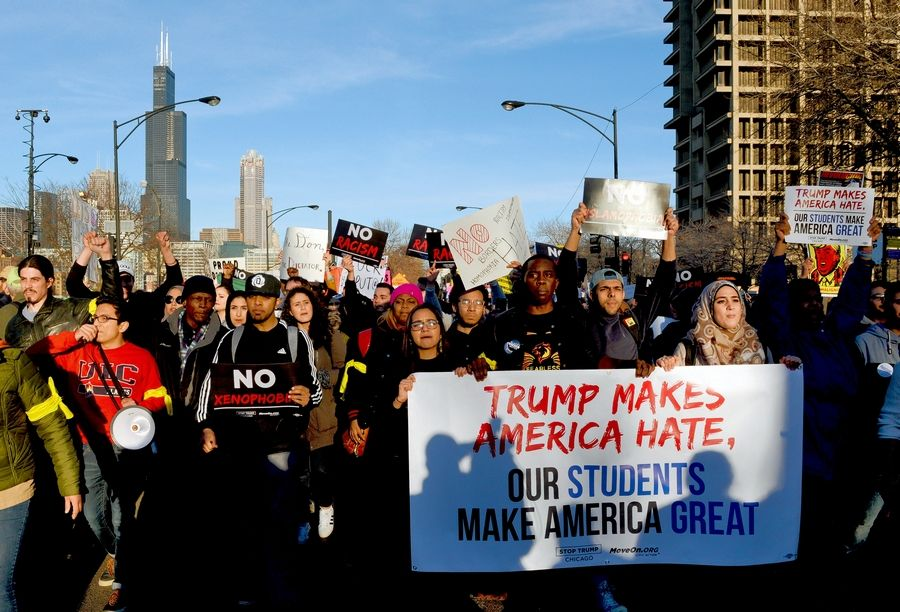 A 2016 photo showing protesters marching in Chicago before a rally for then-candidate Donald Trump was altered on a social media post to falsely depict a call for violence.