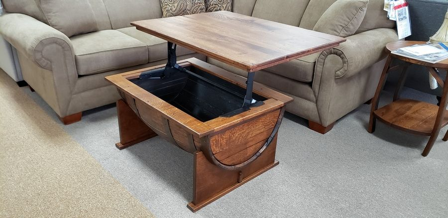 This small table opens up for those who want to eat of work in front of the television.