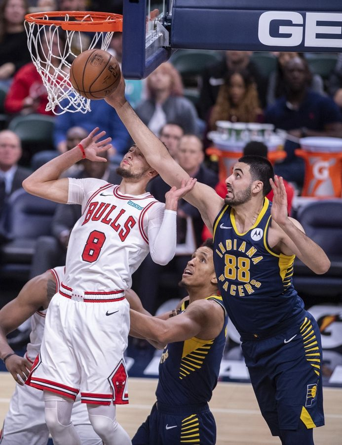 Indiana Pacers center Goga Bitadze (88) blocks Chicago Bulls guard Zach LaVine (8) from getting a rebound during the second half of an NBA basketball game in Indianapolis, Sunday, Nov. 3, 2019.