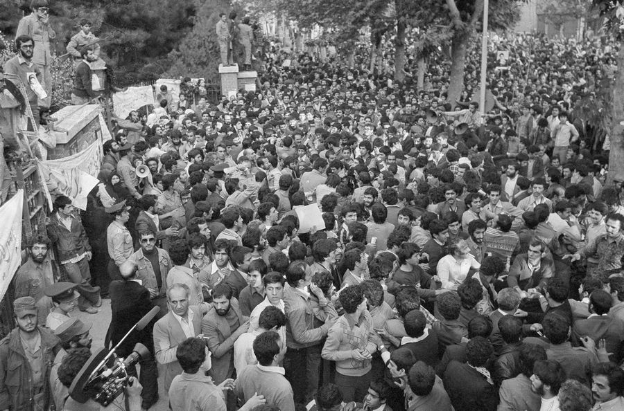 A mass of Iranian protesters is held back from the gates of the U.S. Embassy in Tehran, Iran.