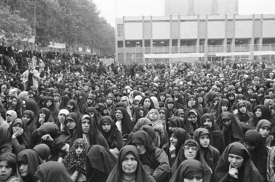 A crowd of Iranian women wearing the traditional chador join an anti-U. S. protest in Tehran, Iran.
