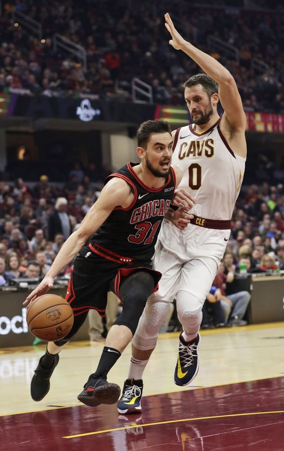 Chicago Bulls' Tomas Satoransky (31) drives against Cleveland Cavaliers' Kevin Love (0) during the first half of an NBA basketball game Wednesday, Oct. 30, 2019, in Cleveland.