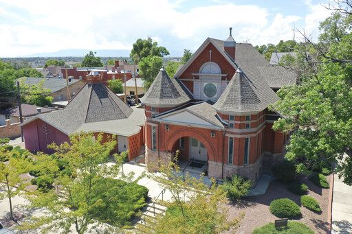 This Thursday, Aug. 22, 2019, photograph, shows an aerial view of Temple Emanuel in Pueblo, Colo. Richard Holzer was charged with a federal hate crime Monday, Nov. 4, 2019, for his part in a plot to bomb the synagogue, which is the second-oldest congregation in Colorado. (Zachary Allen/The Pueblo Chieftain via AP)