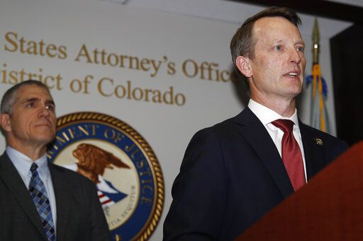 Jason R. Dunn, U.S. Attorney for the District of Colorado, right, makes a point as Dean Phillips, FBI special agent in charge, listens during a news conference in Denver Monday, Nov. 4, 2019, to announce the arrest of a man who repeatedly espoused anti-Semitic views in a plot to bomb a historic Colorado synagogue in Pueblo. Richard Holzer, 27, of Pueblo, was charged with a federal hate crime for plotting to blow up the Temple Emmanuel Synagogue in the southern Colorado city.