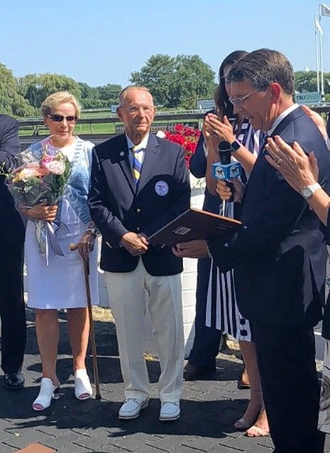 Arlington Heights Mayor Tom Hayes read a proclamation in August in honor of Dick Duchossois, the chairman emeritus of Arlington International Racecourse, alongside Duchossois' wife, Judi.