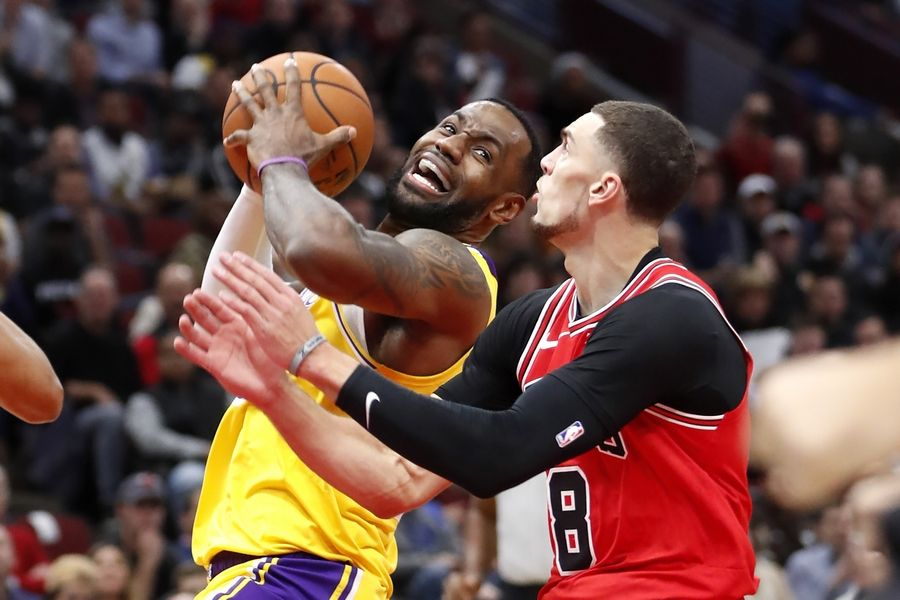 Los Angeles Lakers' LeBron James, left, drives to the basket past Chicago Bulls' Zach LaVine during the first half of an NBA basketball game Tuesday, Nov. 5, 2019, in Chicago.