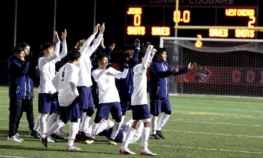 West Chicago's players celebrate a 2-0 win over Jacobs in supersectional boys soccer action at Charlie O. Feutz Field on the campus of Conant High School in Hoffman Estates Tuesday night.