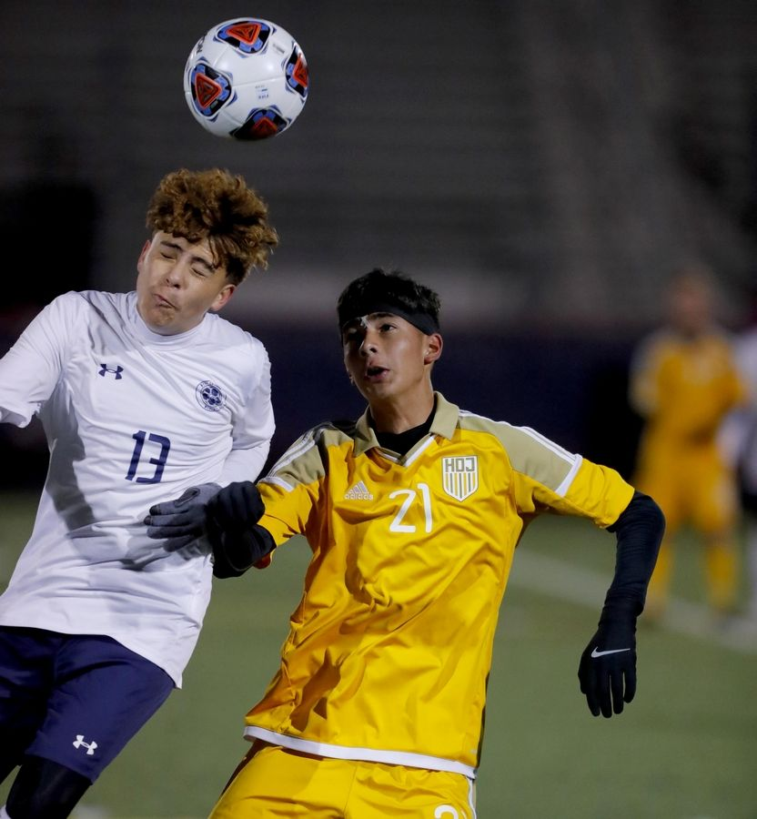 West Chicago's Brayam Barrios, left and Jacobs' Ruben Zarate battle for the ball during supersectional boys soccer action at Charlie O. Feutz Field on the campus of Conant High School in Hoffman Estates Tuesday night.