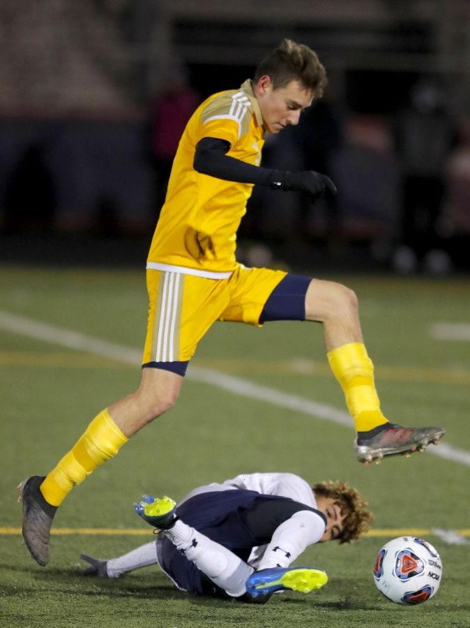 Jacobs' Alex Nicastro leaps over West Chicago's Brayam Barrios during supersectional boys soccer action at Charlie O. Feutz Field on the campus of Conant High School in Hoffman Estates Tuesday night.