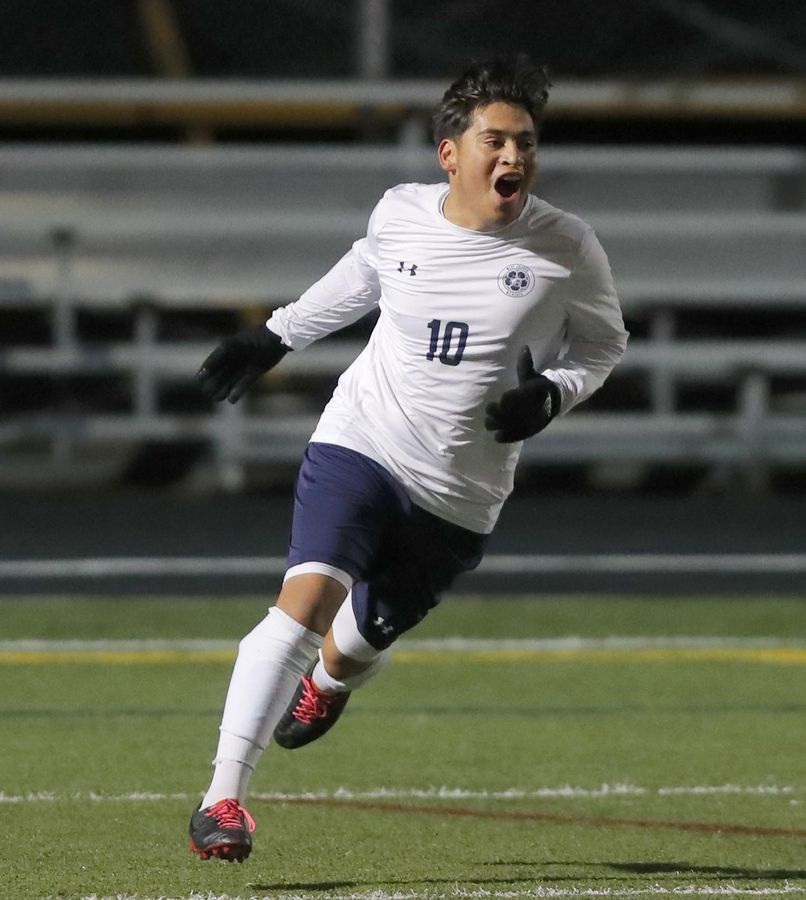 West Chicago's Jessie Hernandez celebrates his first-half goal against Jacobs during supersectional boys soccer action at Charlie O. Feutz Field on the campus of Conant High School in Hoffman Estates Tuesday night.
