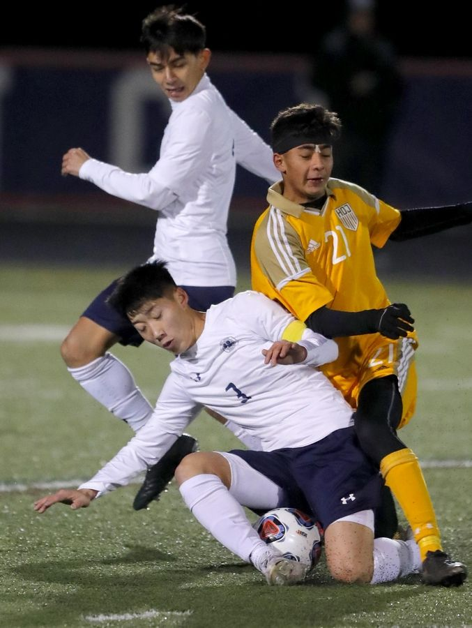 West Chicago's Luis Parra, front left, gets tangled up with Jacobs' Ruben Zarate during supersectional boys soccer action at Charlie O. Feutz Field on the campus of Conant High School in Hoffman Estates Tuesday night. At upper left is West Chicago's Bryan Bonilla.