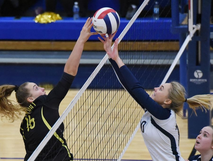 Fremd's Claudia Wala and Glenbrook South's Vanessa Kuliga battle at the net in the third game in the girls volleyball sectional final match in Park Ridge Wednesday.