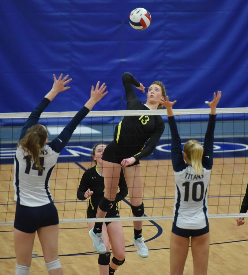 Fremd's Rylen Reid takes a shot against Glenbrook South's Emma Almburg and Vanessa Kuliga in the girls volleyball sectional final match in Park Ridge Wednesday.