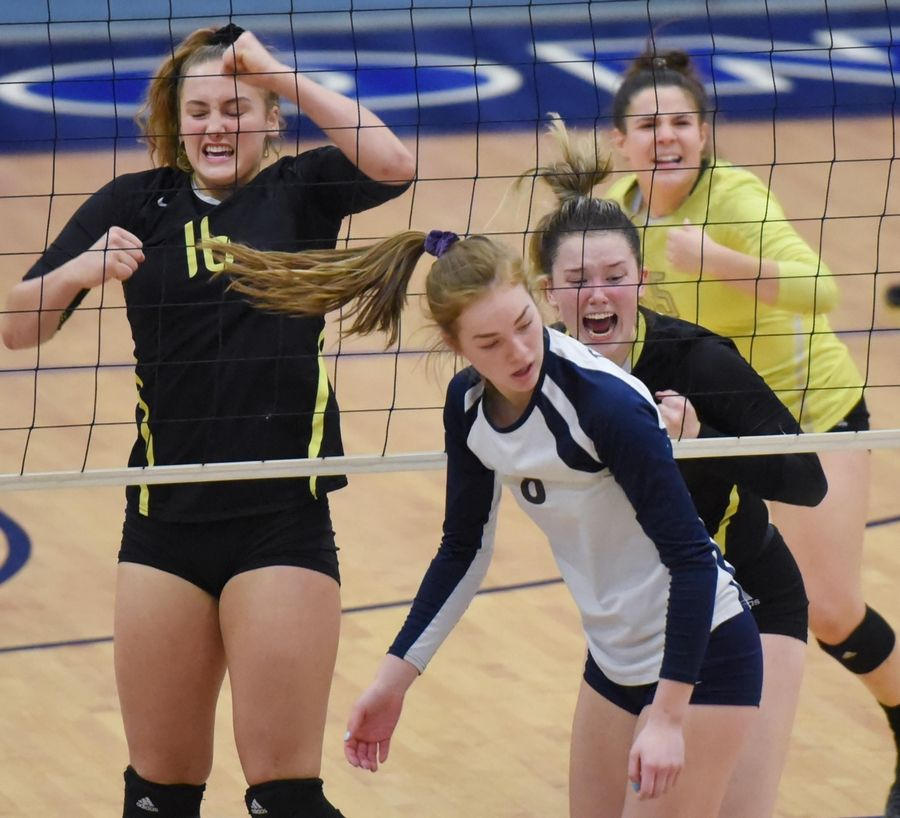 Fremd's Claudia Wala, Breslen Reid and Izzy Segoviano react to a blocked shot against Glenbrook South's Ashley Carr in the girls volleyball sectional final match in Park Ridge Wednesday.