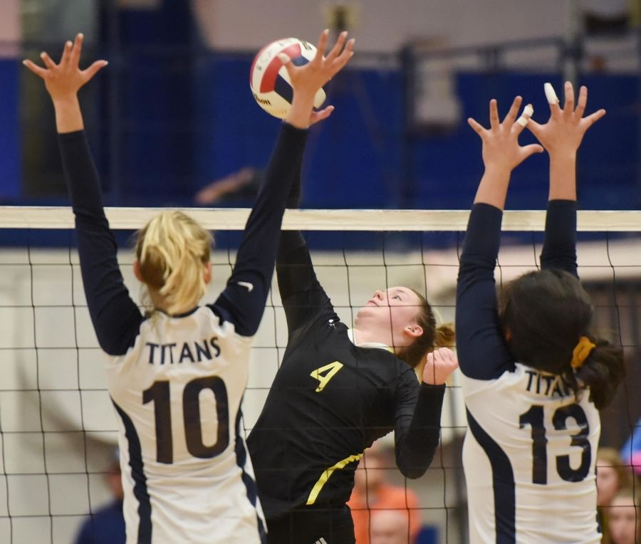 Fremd's Breslen Reid hits into Glenbrook South's Vanessa Kuliga and Megan Lee in the girls volleyball sectional final match in Park Ridge Wednesday.