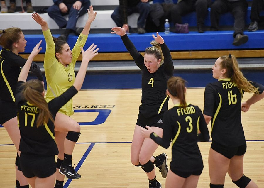 Fremd's Breslen Reid leads her team in a point celebration against Glenbrook South in the girls volleyball sectional final match in Park Ridge Wednesday.