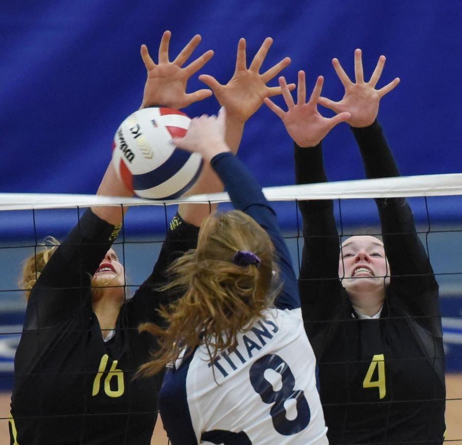 Fremd's Claudia Wala and Breslen Reid block a shot by Glenbrook South's Ashley Carr in the girls volleyball sectional final match in Park Ridge Wednesday.