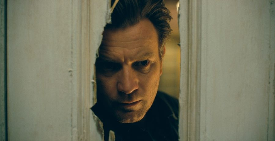 "A grown-up Danny Torrance (Ewan McGregor) revisits the haunted hotel of his youth in Mike Flanagan's sluggish but intriguing ""Doctor Sleep,"" Stephen King's sequel to ""The Shining."""