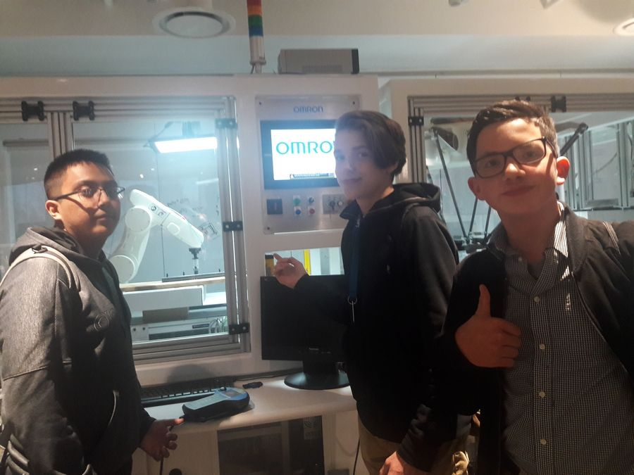 Larkin high school students from the left Jiovanny Gonzalez, Cody Gerber, and Brandon Kelley learning about automation at Omron's student STEM day in November 2019.Diane Kriescher