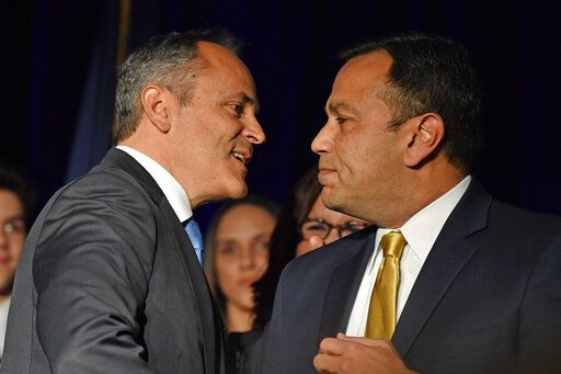 "Kentucky Gov. Matt Bevin, left, and his running mate Ralph Alvarado speak to each other at a Republican Party event in Louisville, Ky., Tuesday, Nov. 5, 2019. Bevin did not concede the race to his opponent, electing to ""wait and see what happens."""