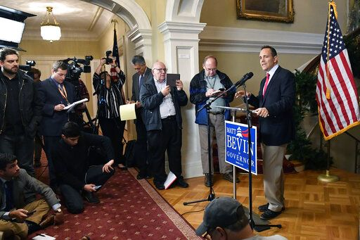 Kentucky Governor Matt Bevin, right, announces his intent to call for a remcanvass of the voting results from Tuesday's gubernatorial elections during a press conference at the Governor's Mansion in Frankfort, Ky., Wednesday, Nov. 6, 2019.