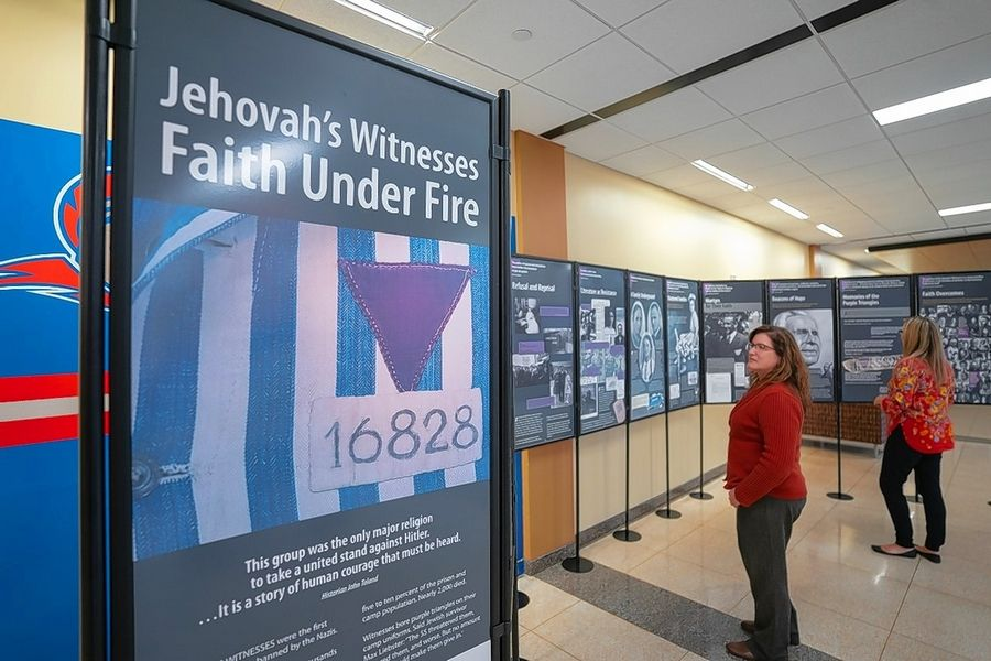 A traveling Holocaust exhibit at Elgin Community College chronicles stories of persecution and the struggles of Jehovah's Witnesses under Nazi rule in Europe.