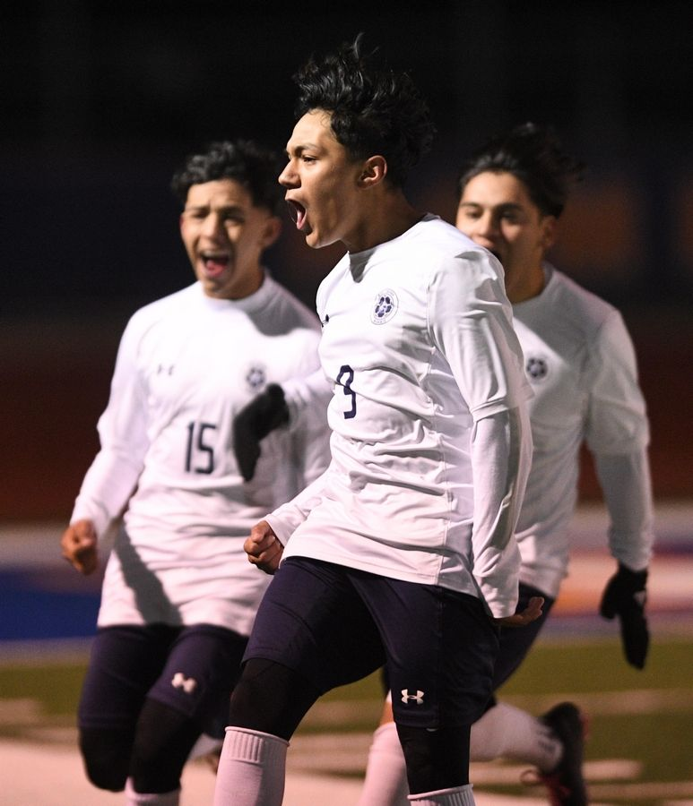 West Chicago's Brian Nieves reacts to his winning goal with teammates Alejandro Cadena and Jessie Hernandez against Edwardsville in the Class 3A boys state semifinal game in Hoffman Estates Friday.