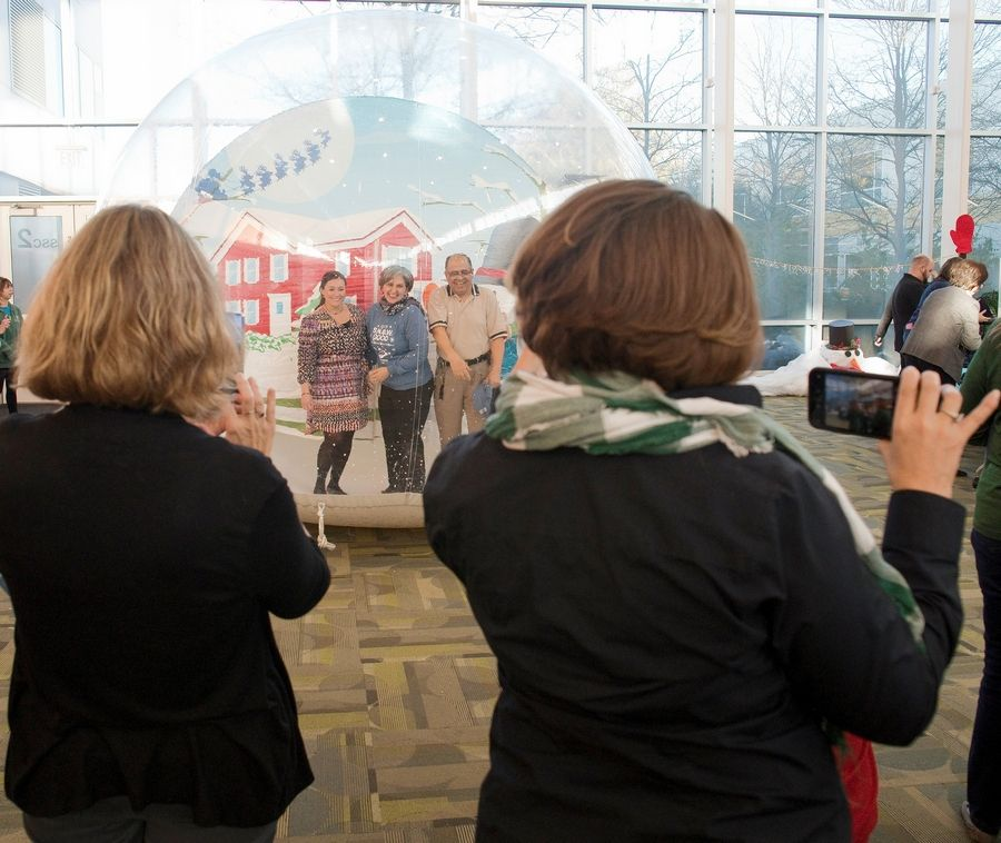 "Attendees at the College of DuPage ""Up to S.N.O.W. Good"" launch party Nov. 5 try out the selfie snow globe."