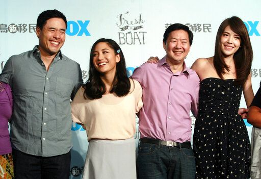 "FILE - In this Aug. 5, 2016 file photo, Randall Park, from left, Constance Wu, Ken Jeong and Ann Hsu pose for photographers during a media event announcing their comedy series ""Fresh off the Boat"" in Taipei, Taiwan. ABC's 'œFresh Off the Boat'� is coming to an end after six seasons. The network said Friday, Nov. 8, 2019,  the comedy about an Asian American family in the 1990s will wrap with an hour-long finale.  The last episode will air Feb. 21. (AP Photo/Chiang Ying-ying, File"