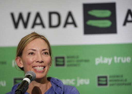 FILE - In this June 5, 2018, file photo, Beckie Scott, World Anti-Doping Agency athlete committee chairperson, speaks at a news conference following the agency's first Global Athlete Forum in Calgary, Alberta One of her proudest accomplishments was getting an athlete charter of rights approved and into the WADA code book. That happened Thursday, Nov. 7, 2019, the last day of her term as chair. 'œMy hope is that going forward, voices that challenge or dissent will be heard and taken into consideration rather than undermined or dismissed,'� Scott said in her speech. 'œAnd my hope is that going forward, balance and independence will be restored to these tables, so that all interests and priorities here are aligned with equality of opportunity and fairness, rather than the business of sport.'�. (Jeff McIntosh/The Canadian Press via AP, File)