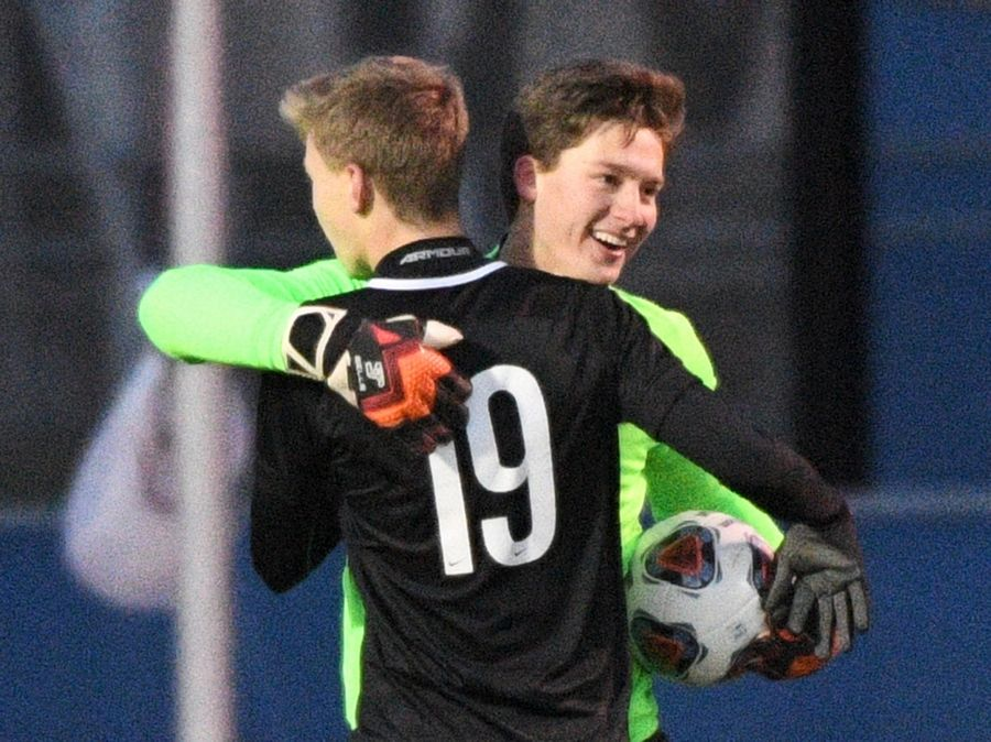 Benet Academy's Vytautas Staniskis and Zach Serafin hug after defeating St. Laurence in the Class 2A boys state semifinal game in Hoffman Estates Friday.