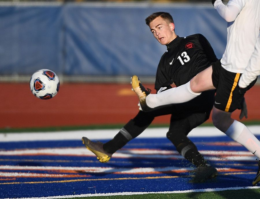 Benet Academy's Nicholas Augustyn scores in the first half against St. Laurence in the Class 2A boys state semifinal game in Hoffman Estates Friday.