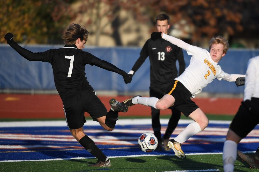 Benet Academy's Christopher Mankowski and St. Laurence's Luke Arthurs battle for the ball in the Class 2A boys state semifinal game in Hoffman Estates Friday.