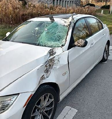 The white BMW whose 53-year-old driver from Glen Ellyn related that a white Nissan was trying to pass him in a no-passing zone before it struck a silver Toyota head-on and also struck the BMW's front driver's side at the intersection of 35th Street and Tartan Lakes Drive in Oak Brook Friday morning.
