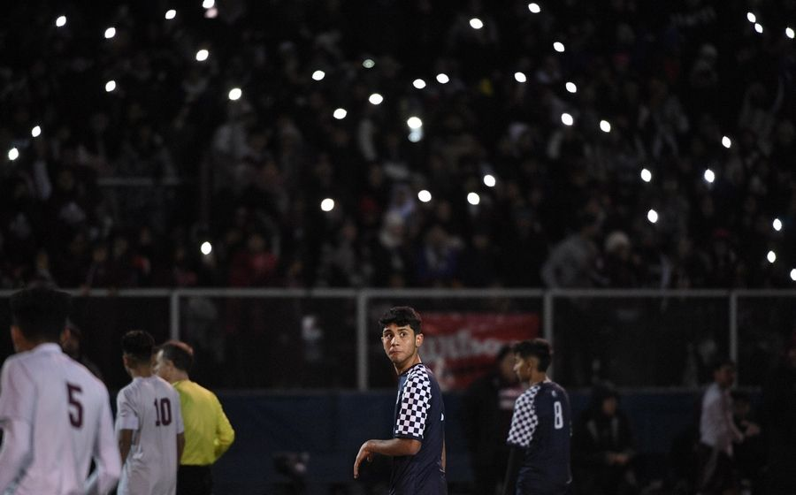 West Chicago's Jahir Martinez looks over his shoulder as the crowd waves their cellphone lights all around the stadium in the Class 3A state soccer championship against Morton in Hoffman Estates Saturday.
