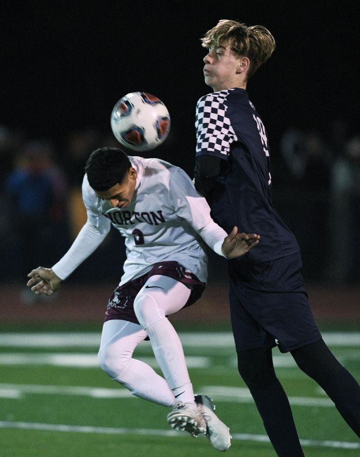 West Chicago's Lukas Stary controls the ball against Morton's Jesus Perez in the Class 3A state soccer championship in Hoffman Estates Saturday.