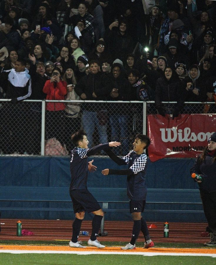 West Chicago's Moises Morfin, right, and teammate Ben Suddeth hug after Morfin scored the first goal against Morton in the Class 3A state soccer championship in Hoffman Estates Saturday.