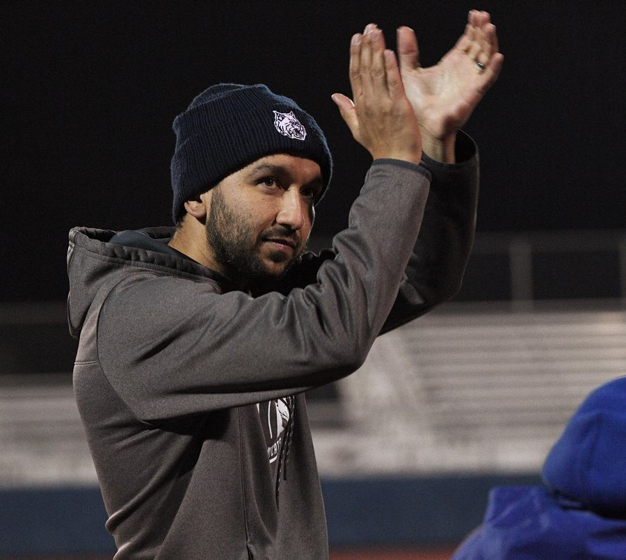 West Chicago head coach Jose Villa applauds the crowd after the Wildcats defeated Morton to win the first school state championship in 45 year in the Class 3A state soccer championship in Hoffman Estates Saturday.