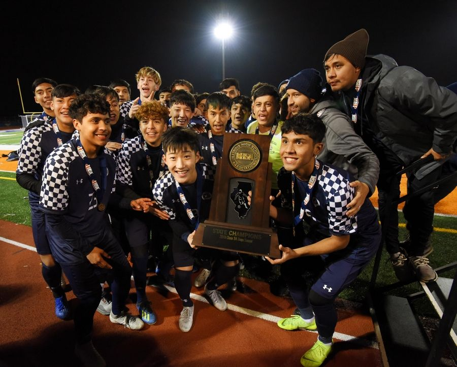 The West Chicago Wildcats hold the first state championship trophy for the school in 45 years after defeating Morton in the Class 3A state soccer championship in Hoffman Estates Saturday.