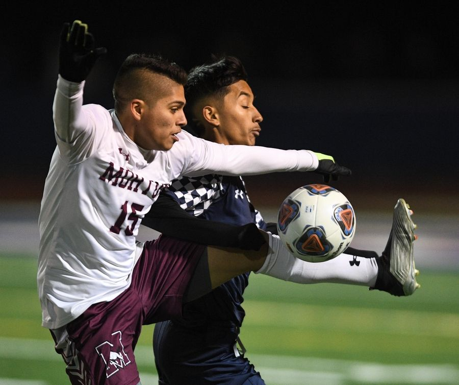 Morton's Adrian Salto and West Chicago's Moises Morfin compete for the ball in the Class 3A state soccer championship in Hoffman Estates Saturday.