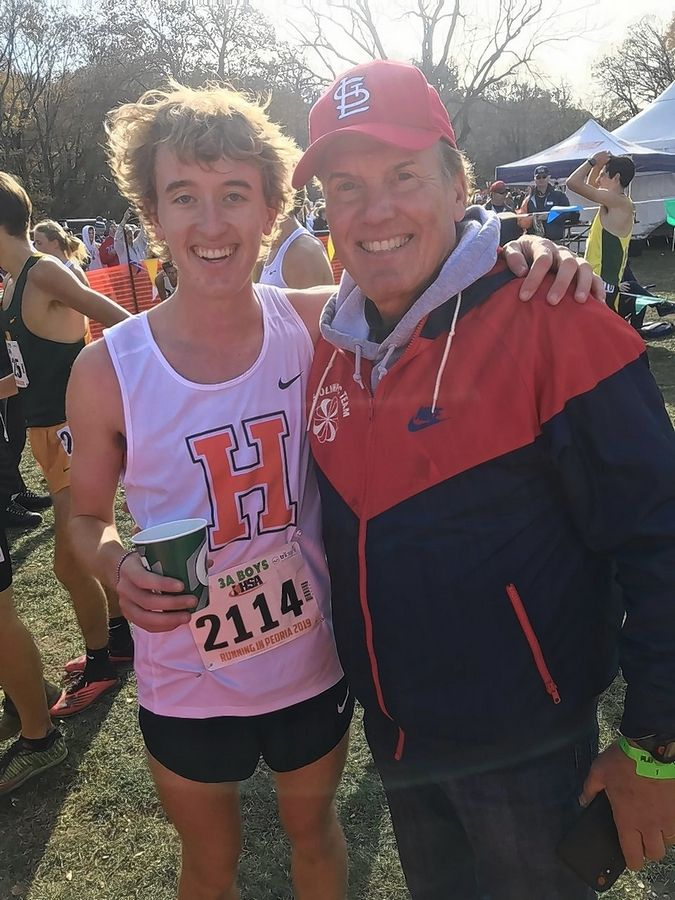 Hersey's Josh Methner, left, is all smiles as he poses with former boys state cross country champion Craig Virgin Saturday at Detweiller Park in Peoria after Methner won his second-straight Class 3A state title. In the process, the Huskies' standout broke the course record that Virgin set in 1972 when he won the title running for Lebanon High School.