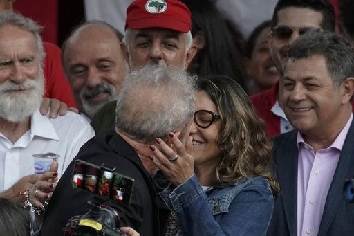 Brazil's former President Luiz Inacio Lula da Silva kisses his girlfriend Rosangela da Silva after exiting the the Federal Police headquarters where he was imprisoned on corruption charges in Curitiba, Brazil, Friday, Nov. 8, 2019. Da Silva walked out of a Curitiba prison Friday, less than a day after the Supreme Court ruled that a person can be imprisoned only after all the appeals have been exhausted.